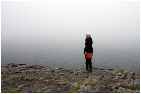 Kelly at the 300ft high cliffs at Dun Aengus
