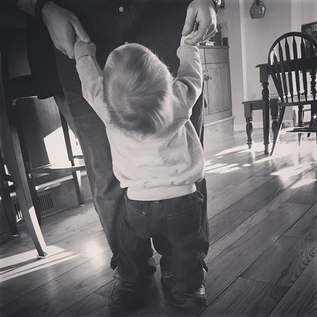 walking on daddy's shoes ?